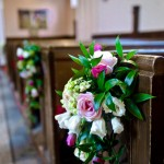 Floral pew ends for a wedding